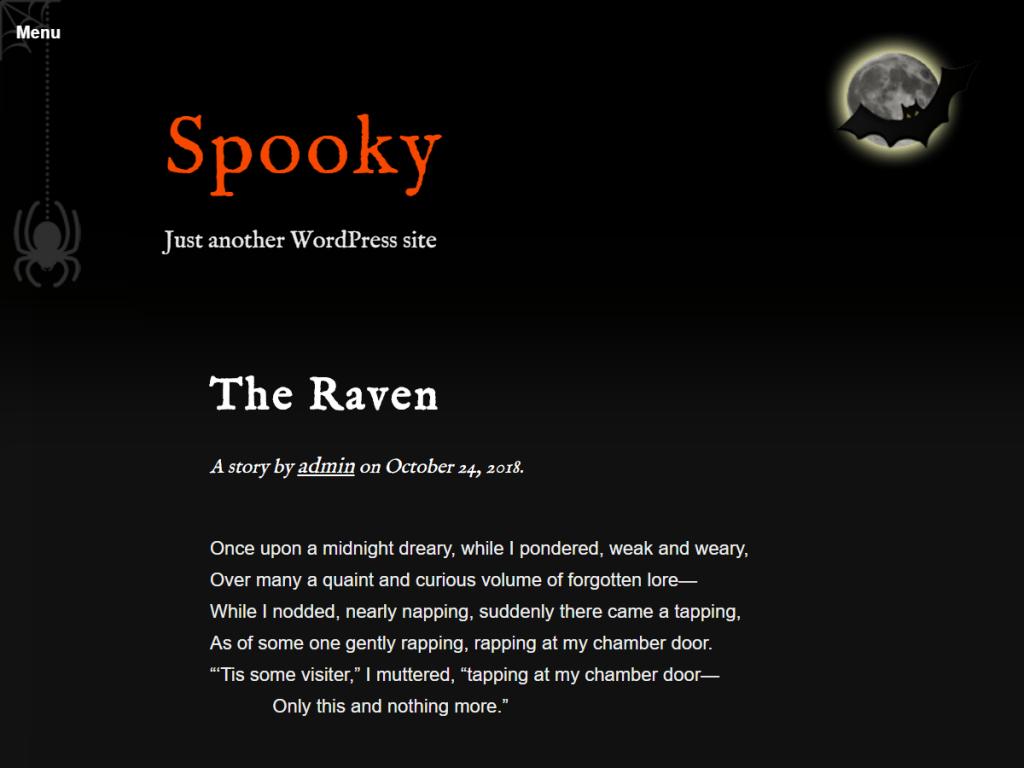 Ett tema till WordPress med svart backgrund, vit text i kursiv stil och orange detaljer. Temat har bilder på en spindel och fladdermöss.