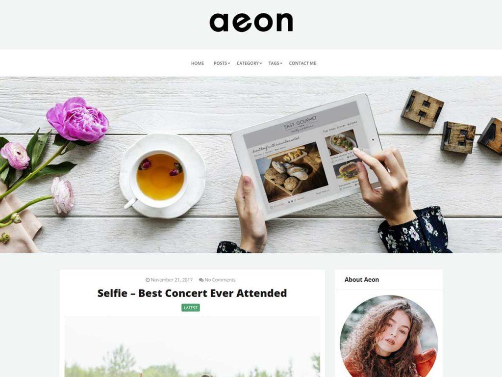 Ett WordPress tema i vitt, ljusgrått, turkost och svagt grönt. Temat har ett fotografi med en kaffekopp i sidhuvudet.